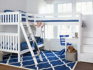 Maxtrix-Corner-Bunk-with-desks-and-blue-chair-white-slatted-with-boy1